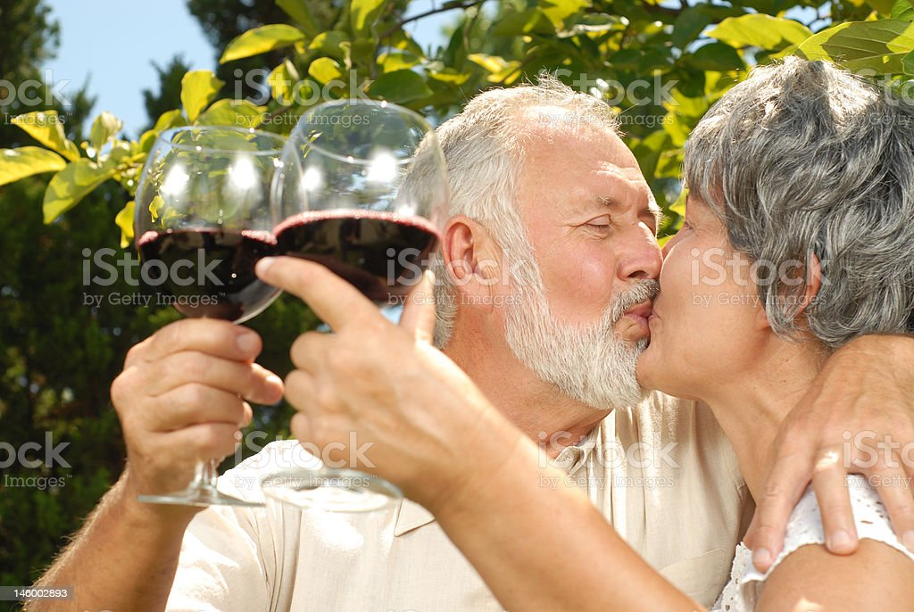 Wine tasting and kisses royalty-free stock photo