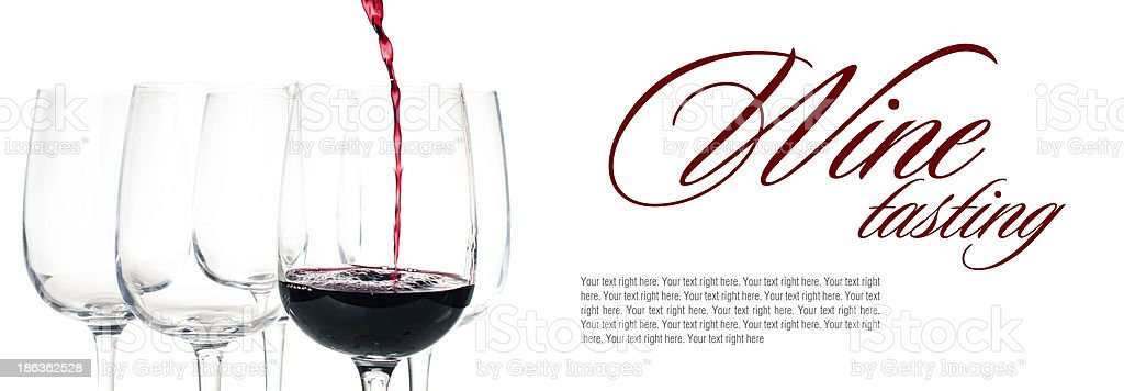 Wine tasting promotion with red wine pouring into a glass stock photo