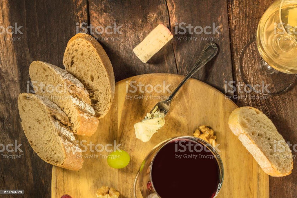 Wine tasting with bread, grapes, and cheese stock photo