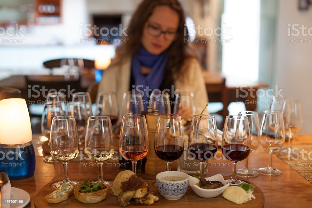 Wine tasting with food accompanied by a beautiful girl stock photo