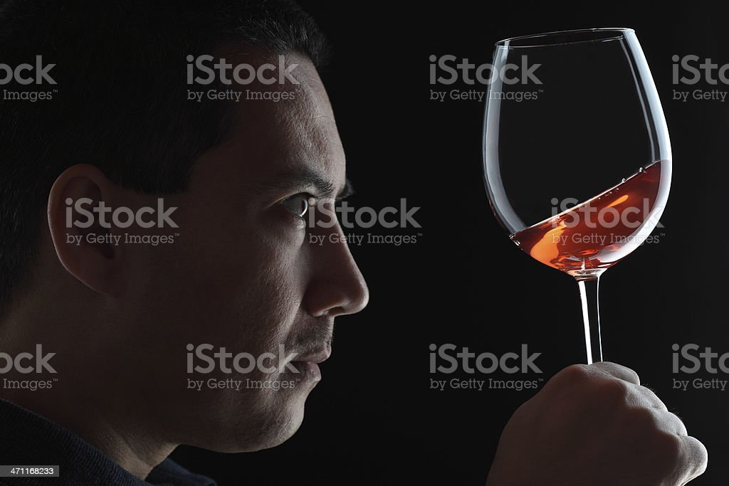 Wine Testing Red Wineglass Black Background royalty-free stock photo