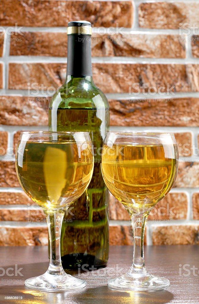 Wineglass and wall stock photo