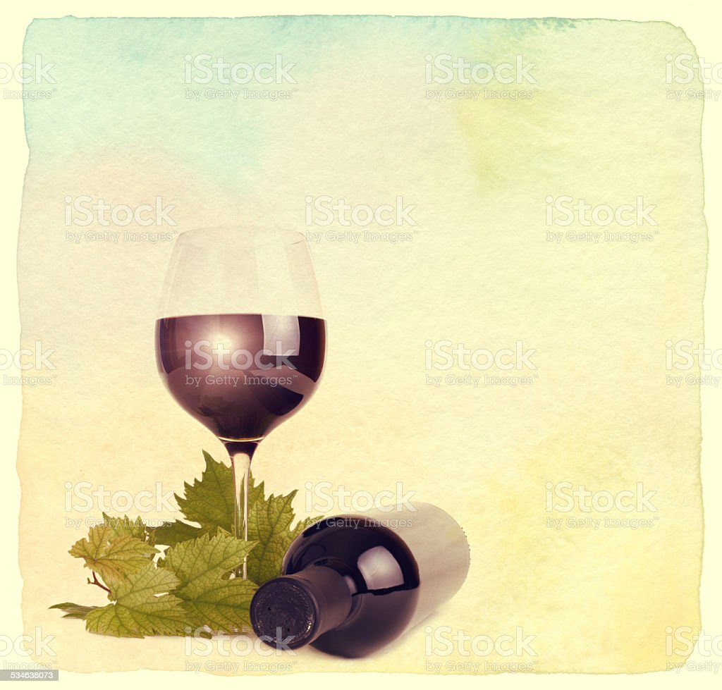 Wineglass, bottle of wine and grapes leaf. stock photo
