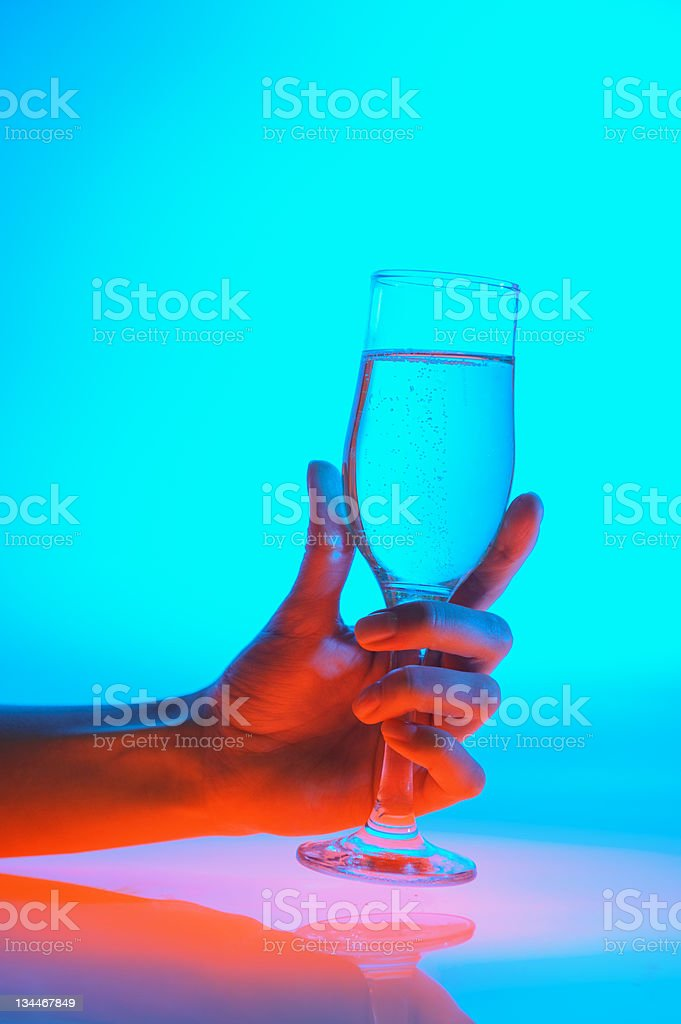 wineglass in a girl's hand royalty-free stock photo