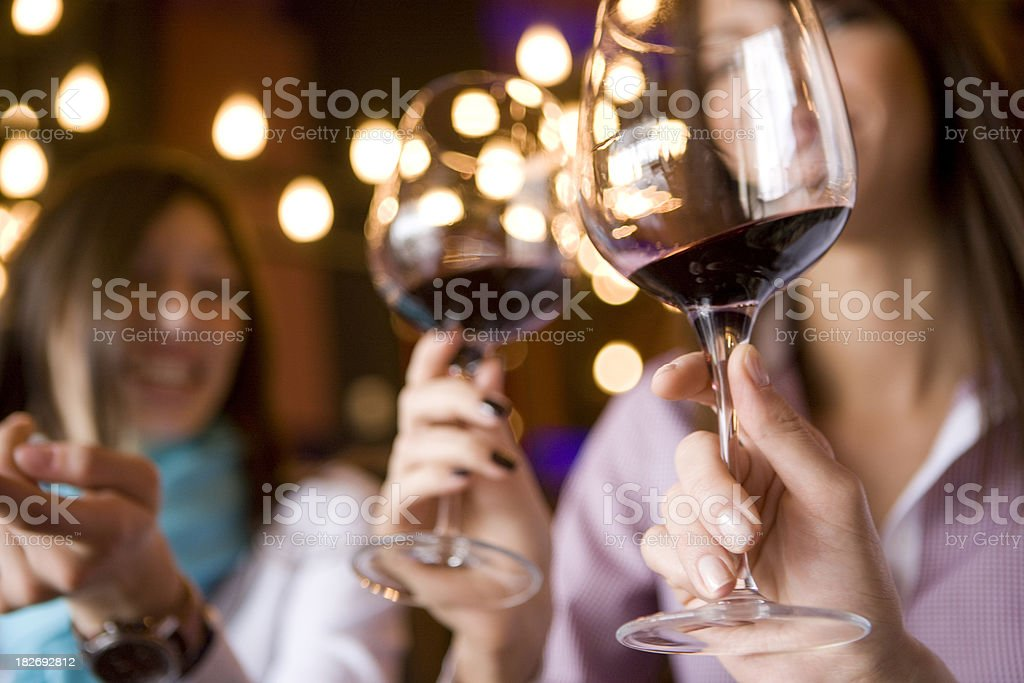 Wineglass in hand stock photo