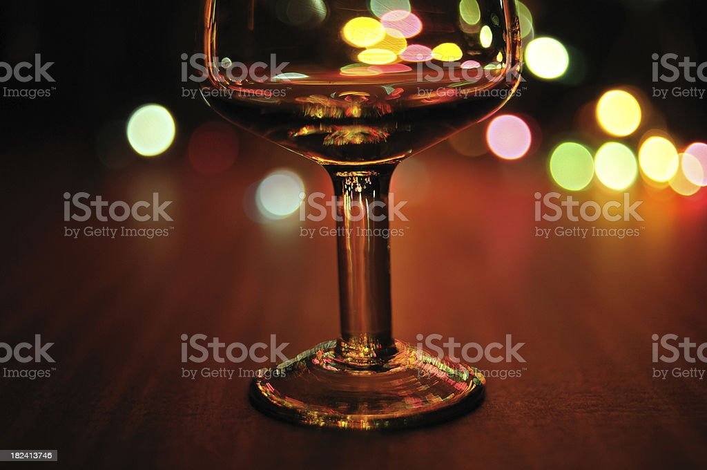 Wineglass in lights royalty-free stock photo