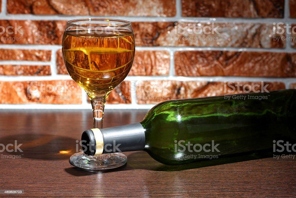 Wineglass on brick stock photo