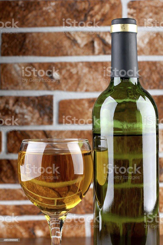 Wineglass on brick wall stock photo
