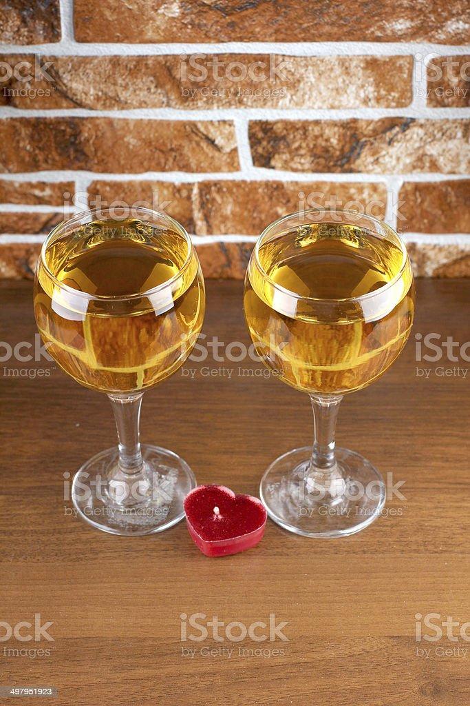 Wineglass on stone stock photo
