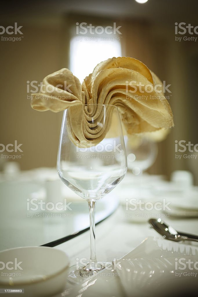 Wineglass with beautiful napkin royalty-free stock photo