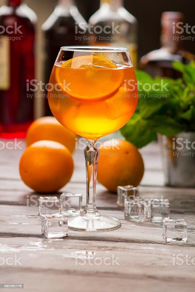 Wineglass with orange beverage. stock photo