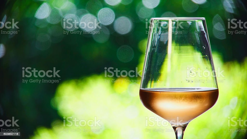 Wineglass with rose wine stock photo