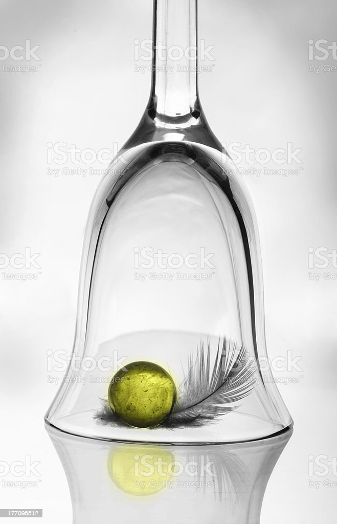 Wineglass, yellow ball and feather royalty-free stock photo