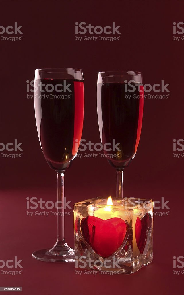 Wineglasses and candle on the white background royalty-free stock photo