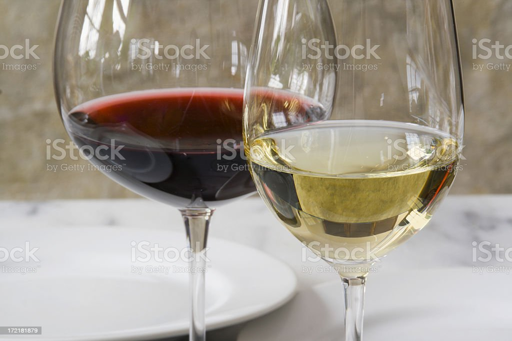 Wineglasses and Place Setting on Dinning Table in Restaurant royalty-free stock photo