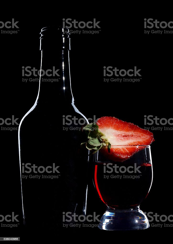 Wineglasses and strawberries stock photo
