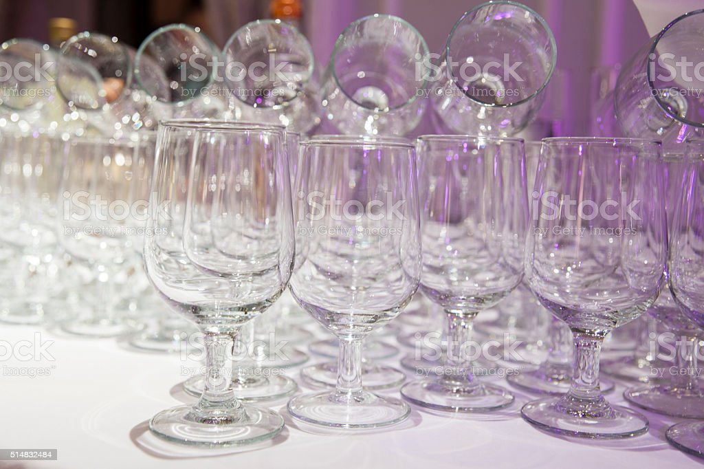 Wineglasses in a bar - abstract composition stock photo