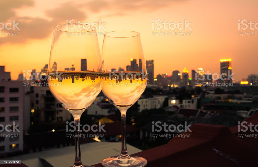 Wineglasses with a city views stock photo