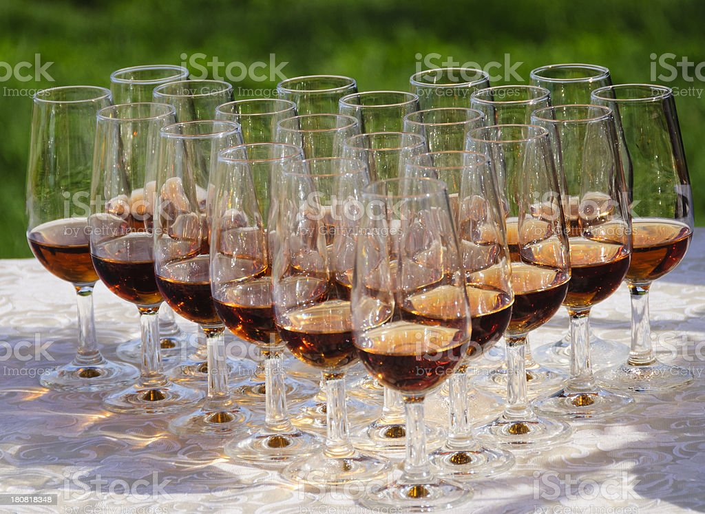 Wineglasses with port wine on a table outdoors stock photo