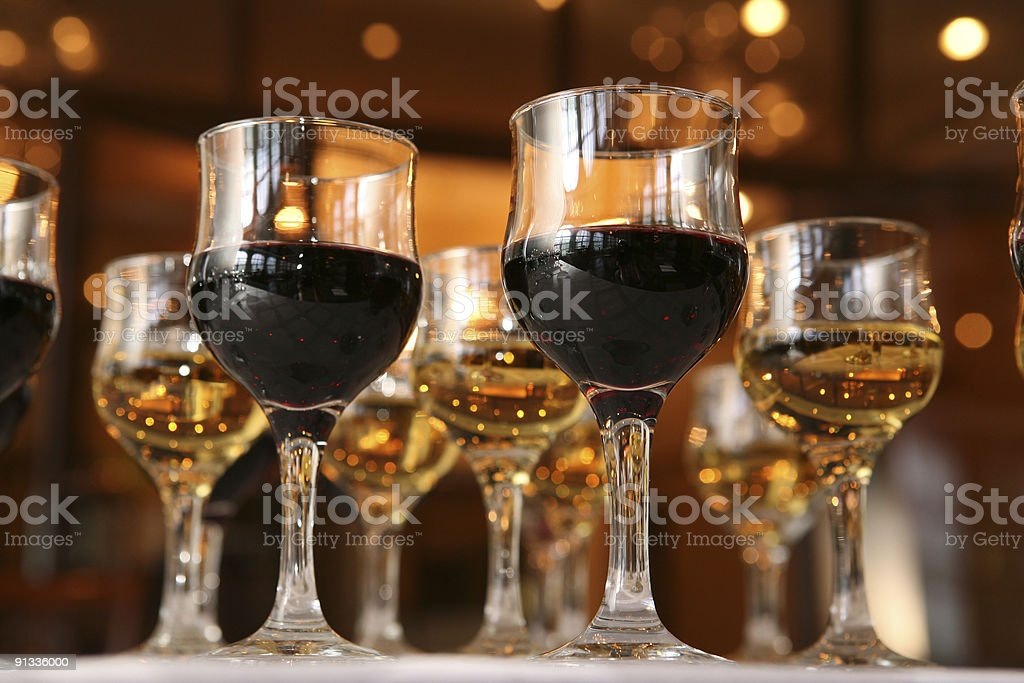 Wineglasses with red and white wine. royalty-free stock photo