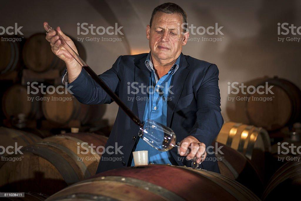 Winemaker Making Wine Test in Winery Cellar, Europe stock photo