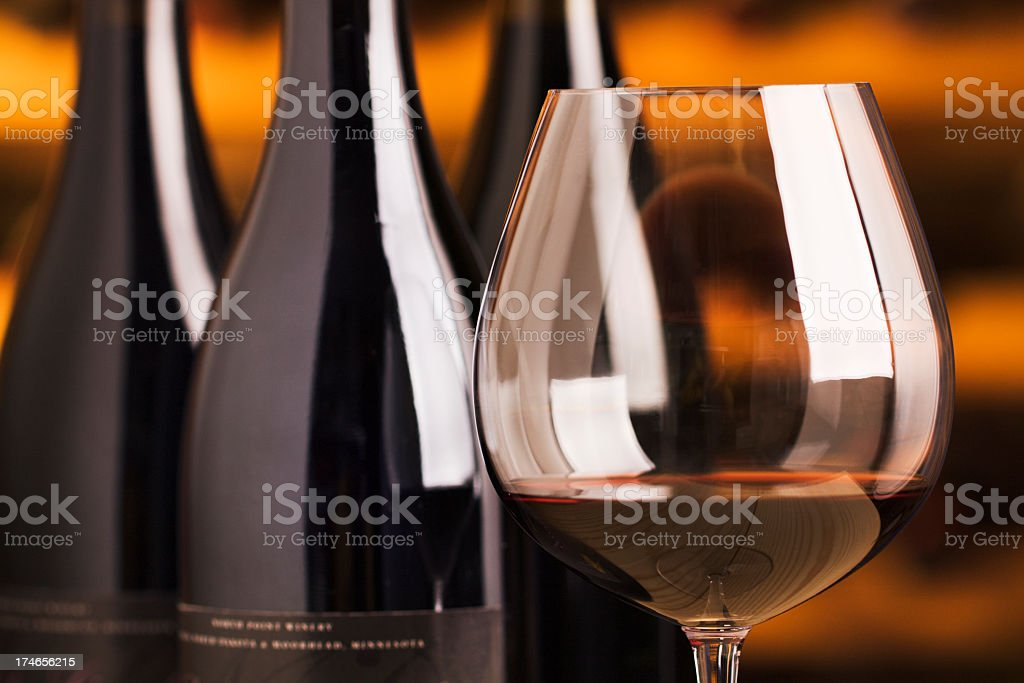 Winetasting Red Wine Glass and Bottles in Cellar for Tasting stock photo