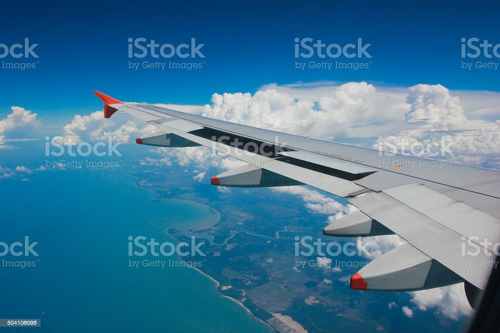 Wing aircraft in altitude during flight stock photo