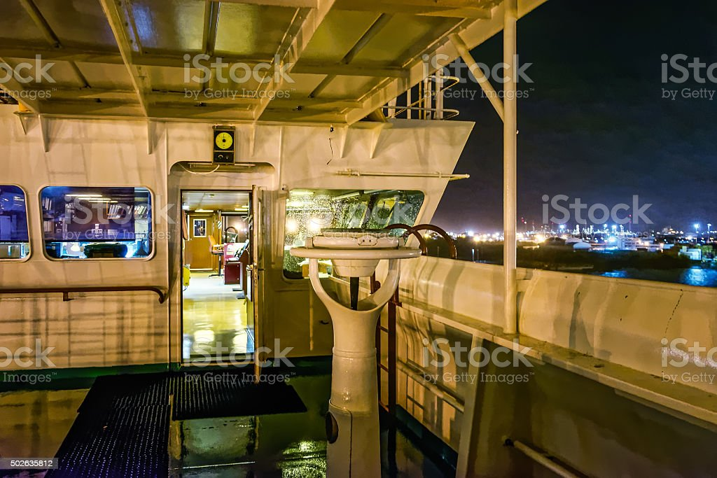 Wing bridge deck of a freighter ship stock photo