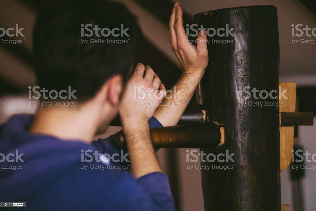 Wing Chun Master Practicing on Wodeen Dummy stock photo