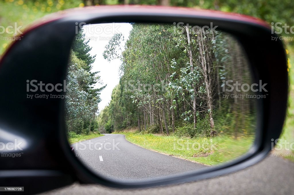 Wing Mirror Reflecting Winding Forest Road royalty-free stock photo