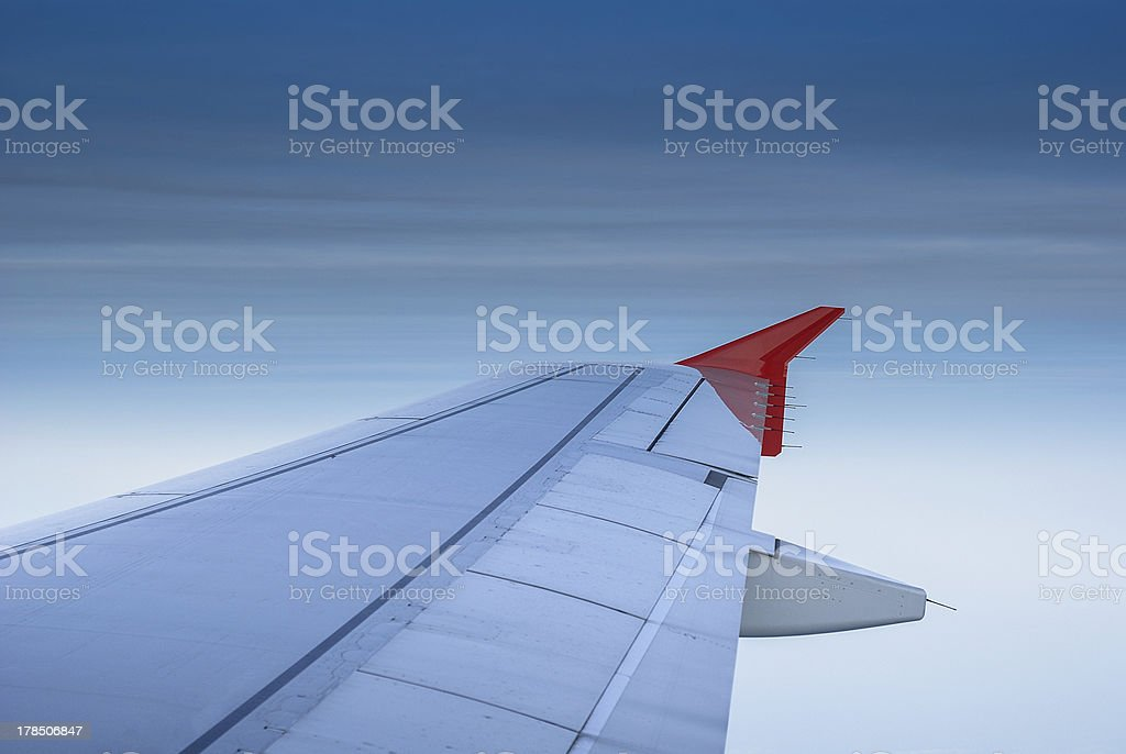 Wing of airplane flying  in the sky royalty-free stock photo