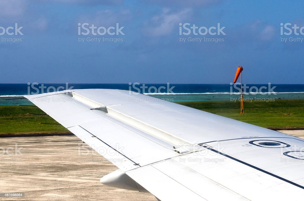 Wing of an airplane during taking off and landing stock photo
