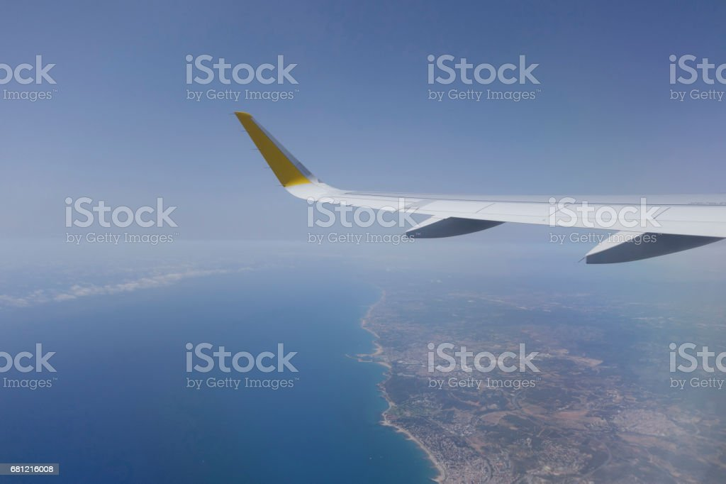 Wing of an airplane flying stock photo