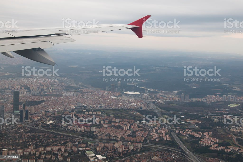 Wing of an airplane with the city of Istanbul, Turkey stock photo