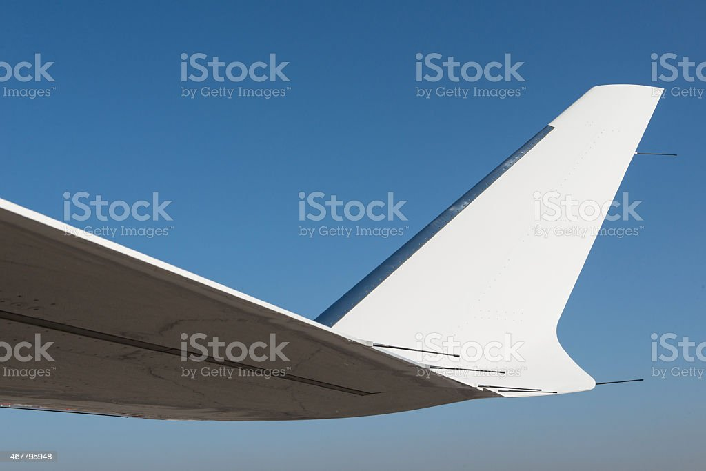 Wing of business jet airplane. stock photo