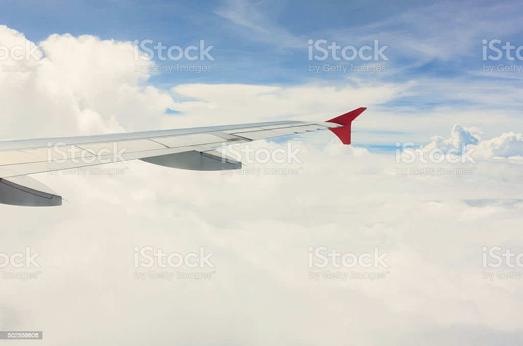 wing of plane on cloud and beautiful blue sky. stock photo