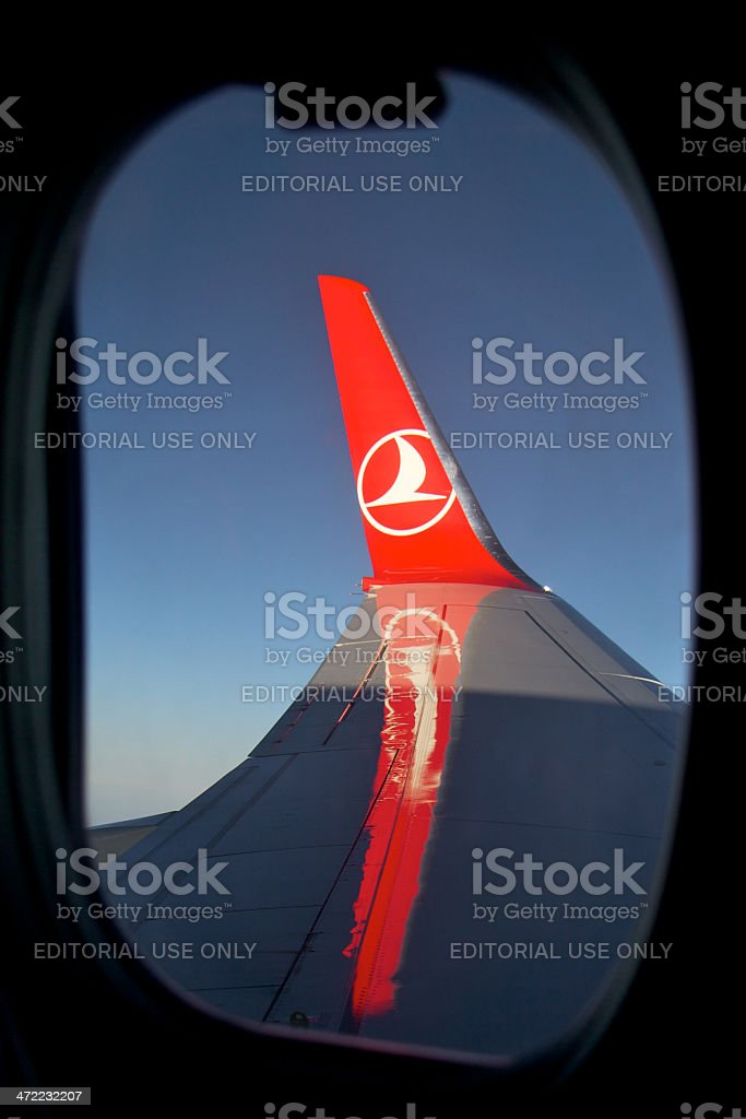 Wing of the airplane from window stock photo