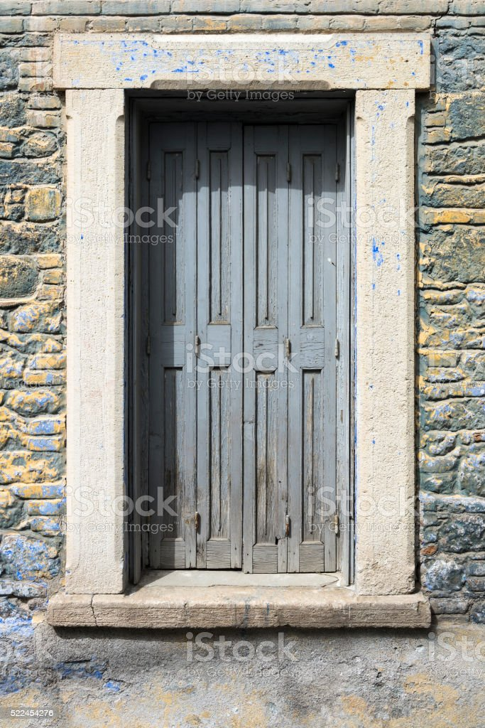 Wing shutters of a traditional stone house stock photo