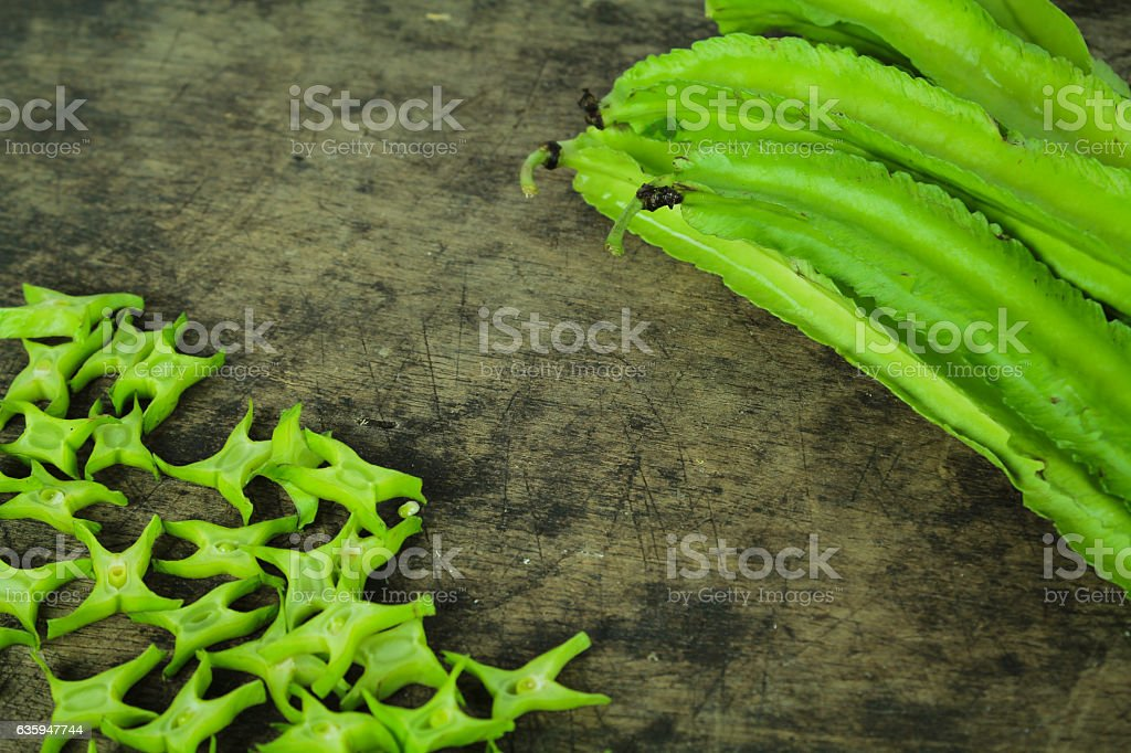 Winged beans on wooden background, Princess bean stock photo