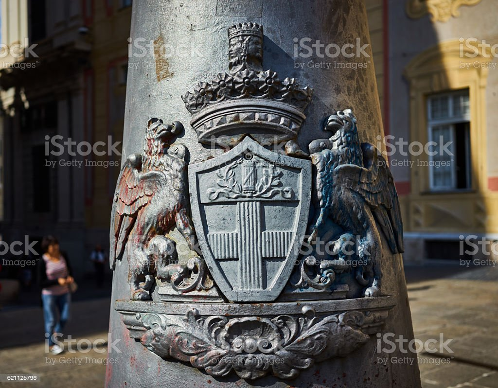 Winged eagle lions holding shield stock photo