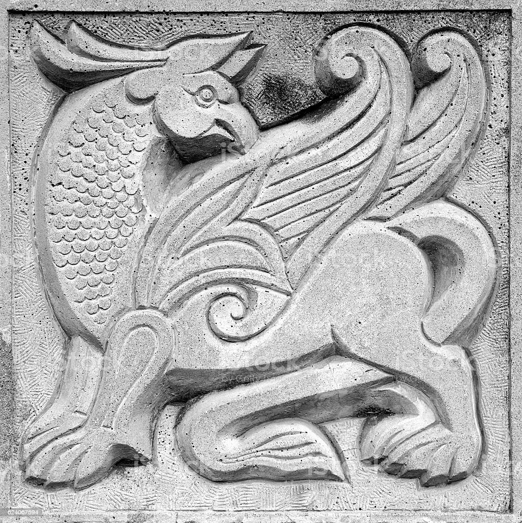winged fairy lion, bas-relief stock photo