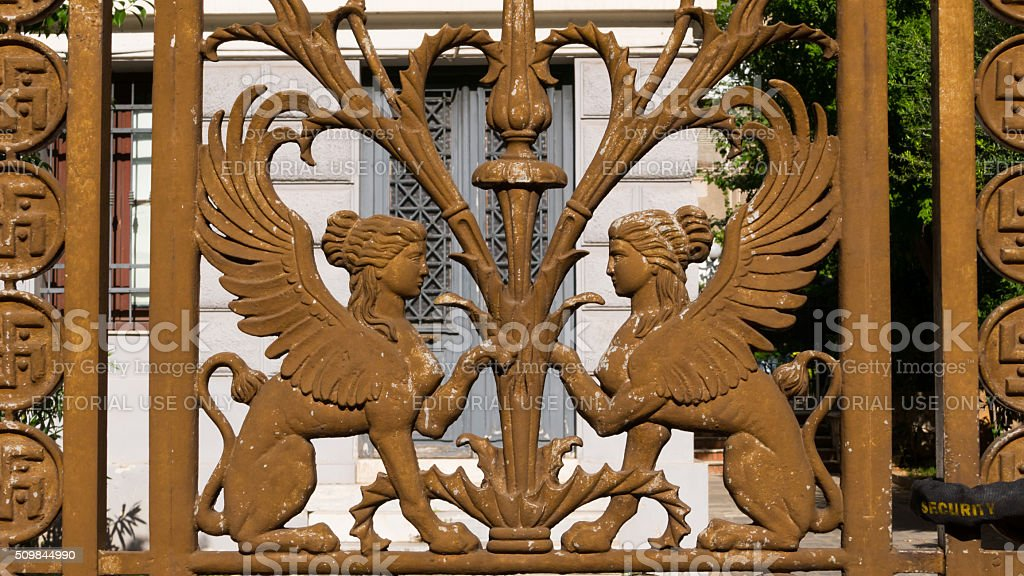 Winged female figure of iron fence, Athens, Greece stock photo