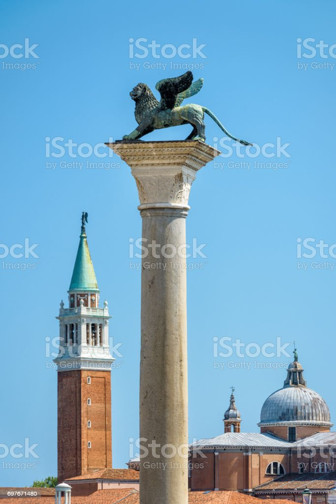Winged lion sculpture on the Piazza San Marco in Venice stock photo