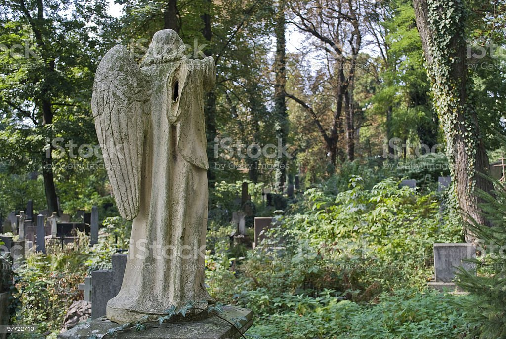 Wingless angel in graveyard stock photo