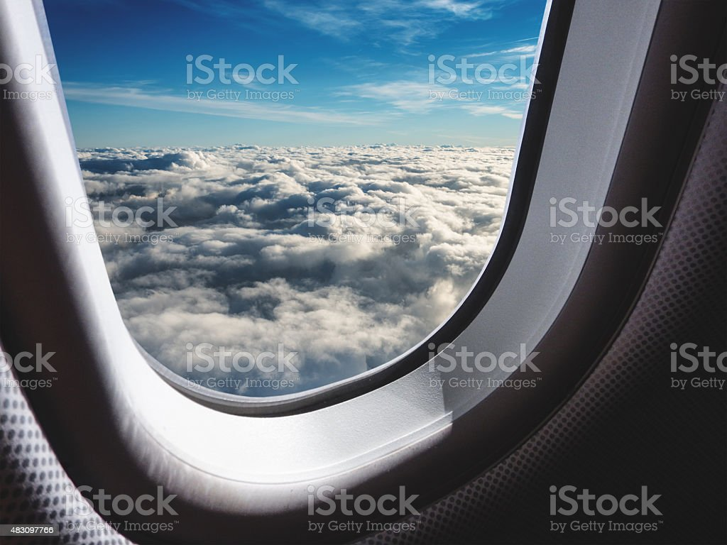 winglet of a commercial airplane from th porthole stock photo