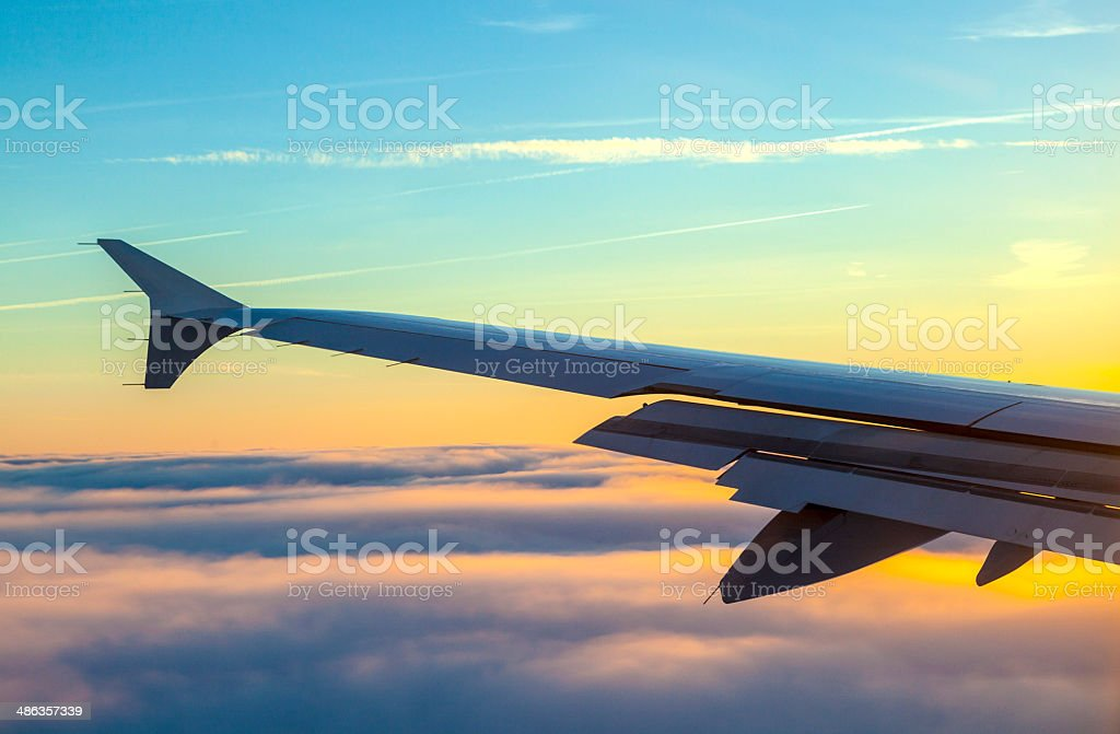 wings of aircraft in sunrise stock photo
