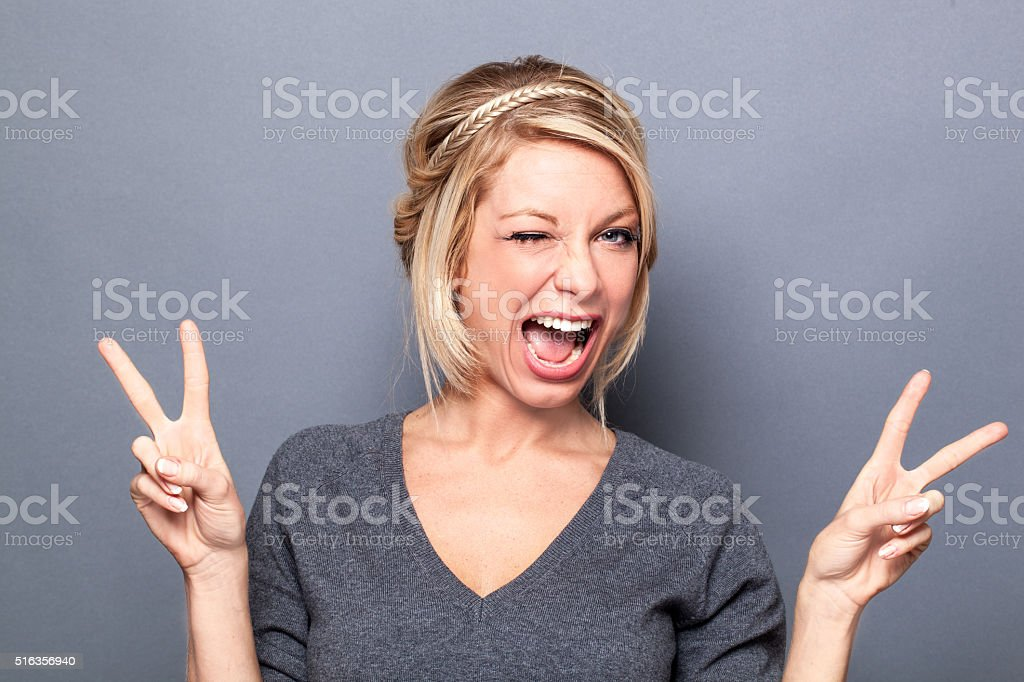 wink and self-confidence concepts for flirting young blond woman stock photo