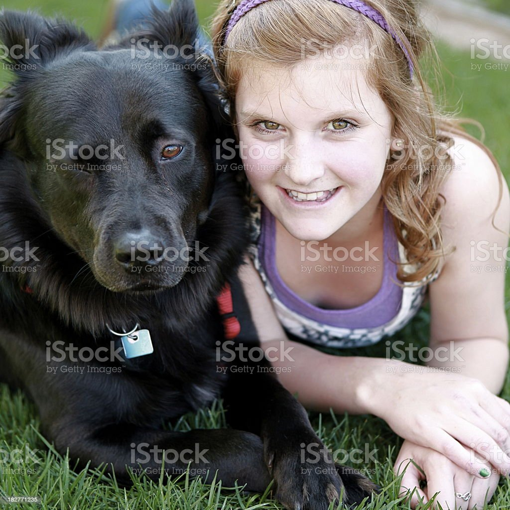 Winking Dog and Smiling Girl royalty-free stock photo