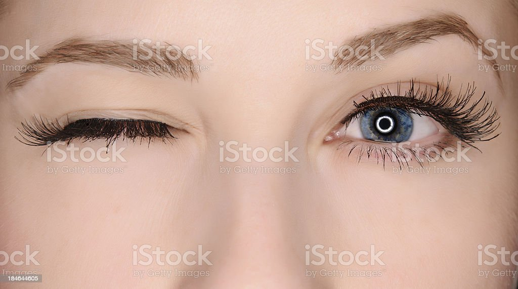 winking eye stock photo