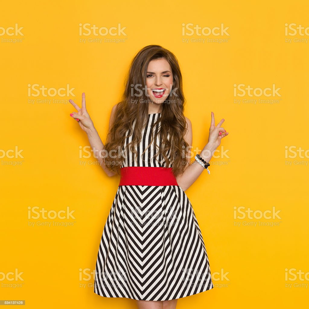 Winking Woman Showing Victor Hand Sign stock photo